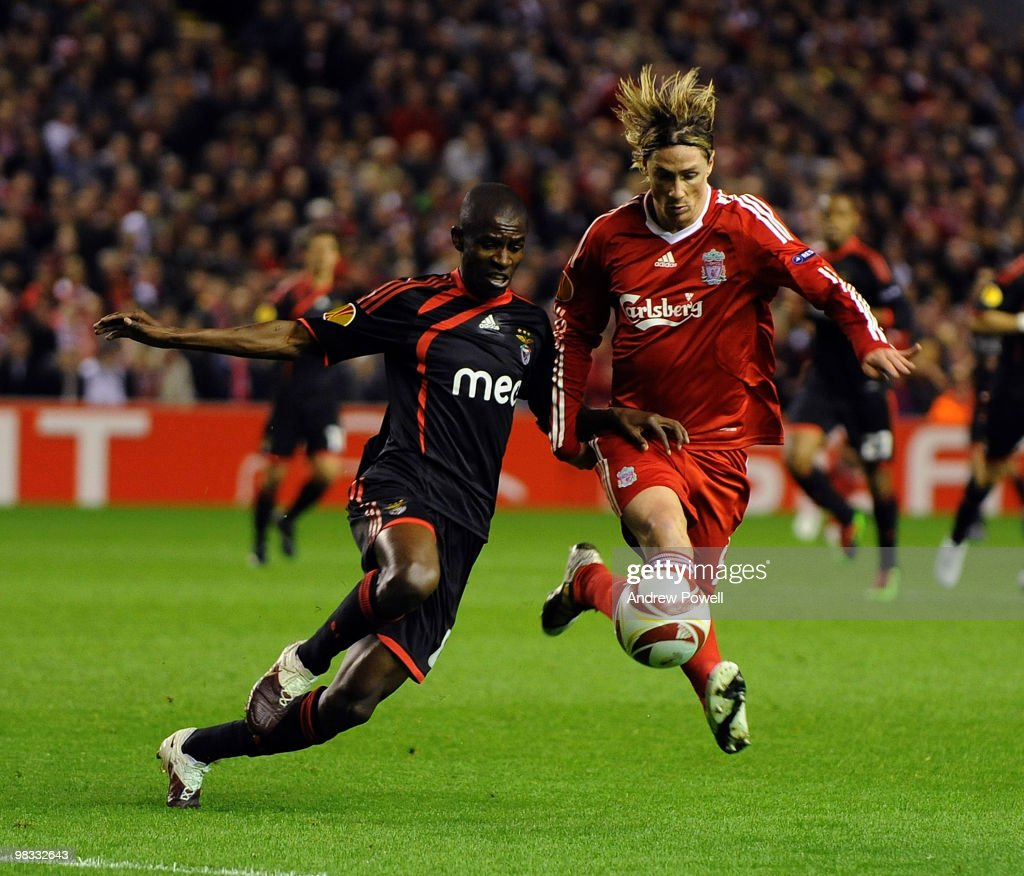 Fernando Torres of Liverpool competes with Ramires of Benfica during the quarter final second leg UEFA Europa League match between Liverpool and Benfica at Anfield on April 8, 2010 in Liverpool, England.