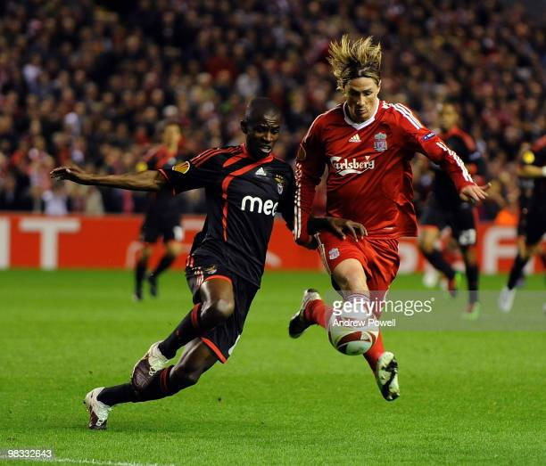 Fernando Torres of Liverpool competes with Ramires of Benfica during the quarter final second leg UEFA Europa League match between Liverpool and...