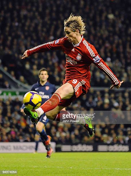 Fernando Torres of Liverpool controls the ball in the air during the Barclays Premier League match between Liverpool and Arsenal at Anfield on...