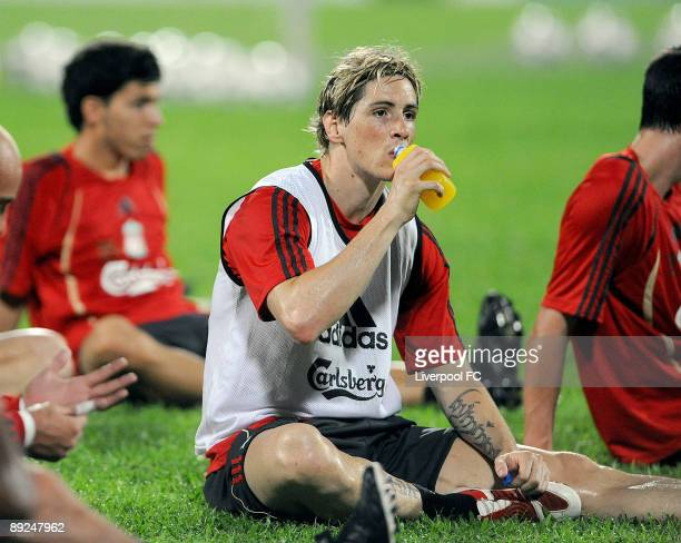Fernando Torres of Liverpool drinks a sports drink during a training session for their pre-season Far East tour at Singapore National Stadium on July...