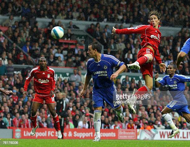 Fernando Torres of Liverpool heads a chance past John Terry of Chelsea during the Premier league football match against Liverpool at Anfield...