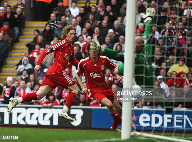 Fernando Torres of Liverpool heads the second goal during the Barclays Premier League match between Liverpool and Blackburn Rovers at Anfield on...