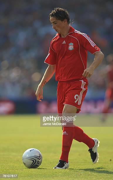 Fernando Torres of Liverpool in action during the Champions League first leg of the third qualifying round match between Toulouse and Liverpool at...