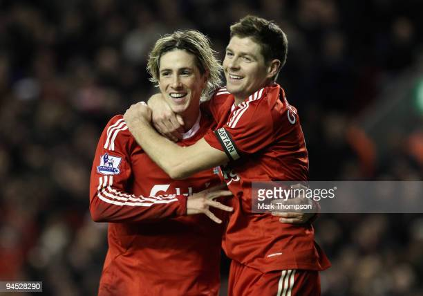Fernando Torres of Liverpool is congratulated by team mate Steven Gerrard after scoring his team's second goal during the Barclays Premier League...
