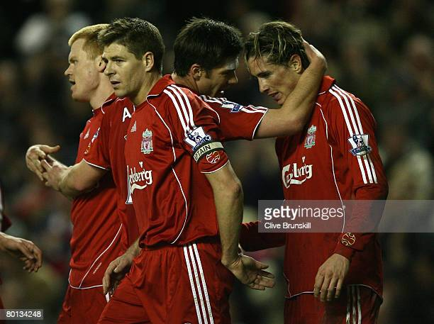Fernando Torres of Liverpool is congratulated by team mate Xabi Alonso after scoring his team's third goal and completing his hattrick during the...