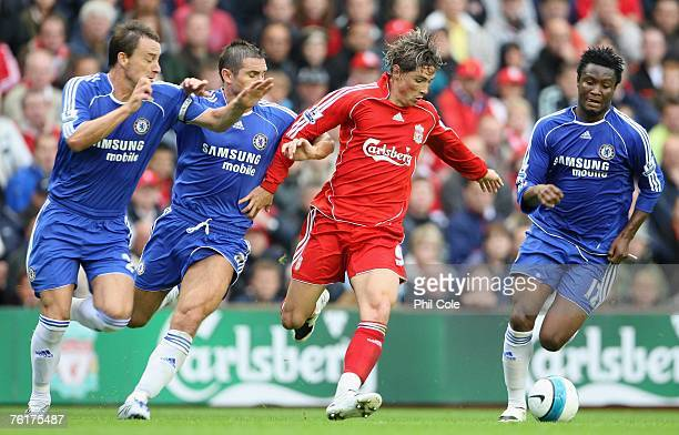 Fernando Torres of Liverpool is pressurised by John Terry Frank Lampard and John Obi Mikel of Chelsea during the Barclays Premier League match...
