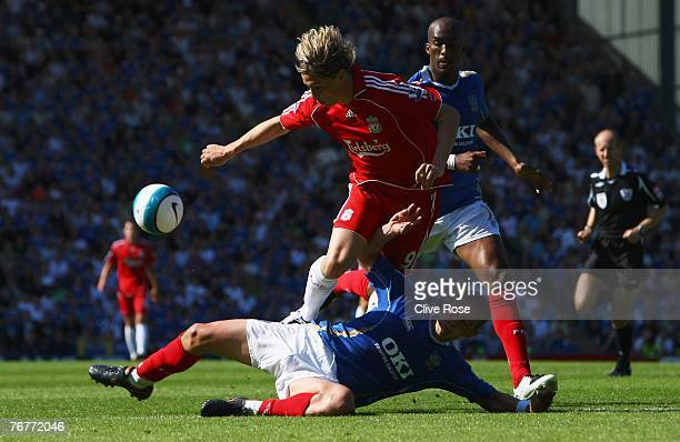 Fernando Torres of Liverpool is tackled by Sean Davis of Liverpool during the Barclays Premiership match between Portsmouth and Liverpool at Fratton...