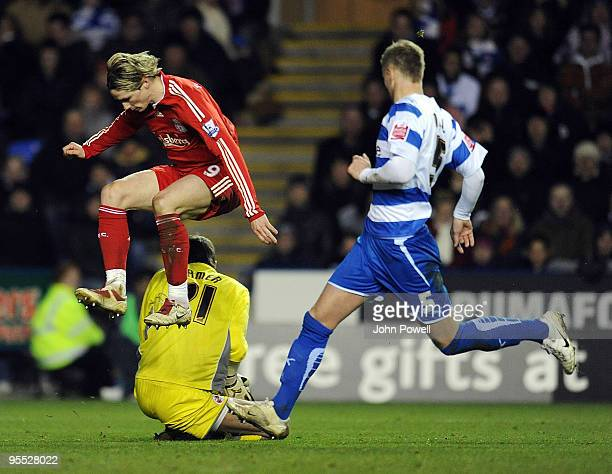Fernando Torres of Liverpool jumps over goalkeeper Ben Hamer of Reading during the FA Cup 3rd round match between Reading and Liverpool at the...