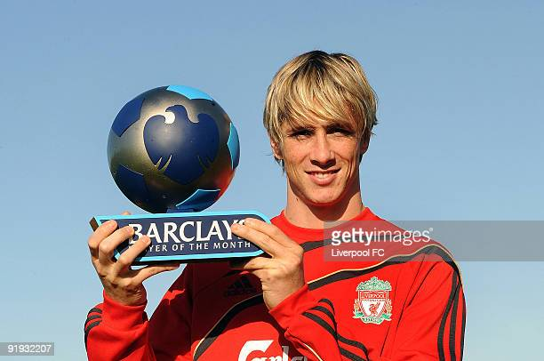 Fernando Torres of Liverpool poses with the Barclays Player of the month Trophy for September at Melwood training ground on October 16 2009 in...