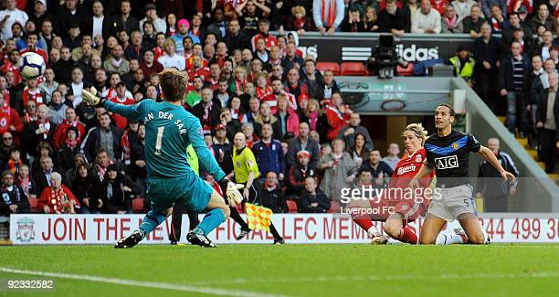 Fernando Torres of Liverpool scores a goal for Liverpool against Manchester United during the match between Liverpool FC and Manchester United at...
