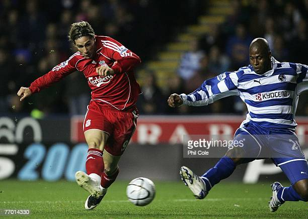 Fernando Torres of Liverpool scores his first and Liverpool's second goal during the Carling Cup third round match between Reading and Liverpool at...