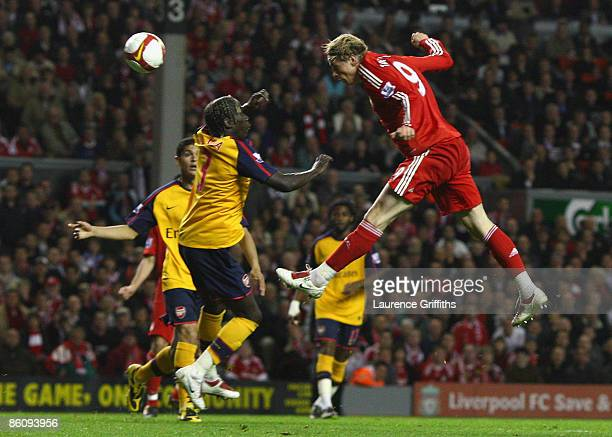 Fernando Torres of Liverpool scores his team's first goal during the Barclays Premier League match between Liverpool and Arsenal at Anfield on April...