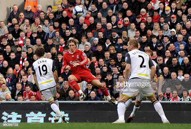 Fernando Torres of Liverpool scores the opening goal during the Barclays Premier League match between Liverpool and Sunderland at Anfield on March 28...