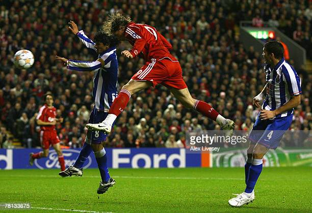 Fernando Torres of Liverpool scores the opening goal during the UEFA Champions League Group A match between Liverpool and FC Porto at Anfield on...