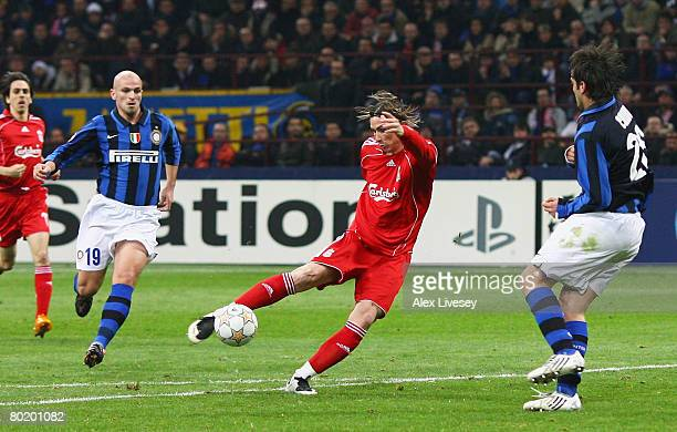 Fernando Torres of Liverpool scores the opening goal during the UEFA Champions League first knockout round second leg match between Inter Milan and...