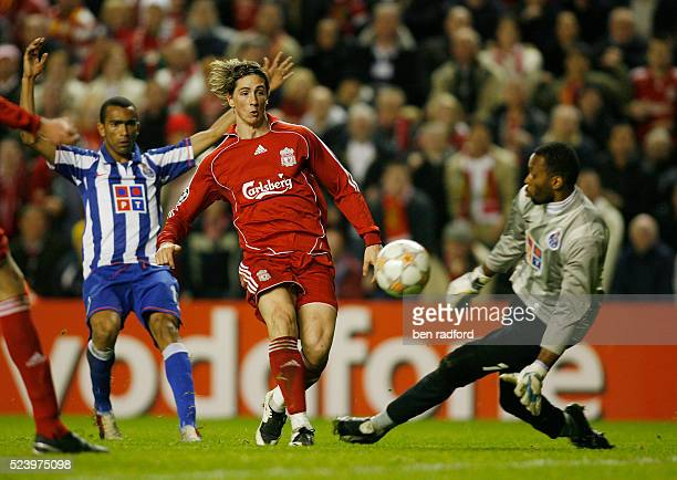 Fernando Torres of Liverpool shoots past Porto goalkeeper Helton to score his second goal during the Group A UEFA Champions League match between...