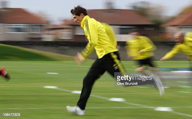 Fernando Torres of Liverpool sprints during a training session ahead of their UEFA Europa League match against SSC Napoli at Melwood Training Ground...