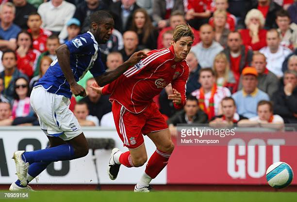Fernando Torres of Liverpool takes on Johan Djourou of Birmingham City during the Barclays Premier League match between Liverpool and Birmingham City...
