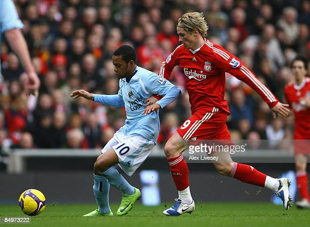 Fernando Torres of Liverpool tussles for posession with Robinho of Manchester City during the Barclays Premier League match between Liverpool and...