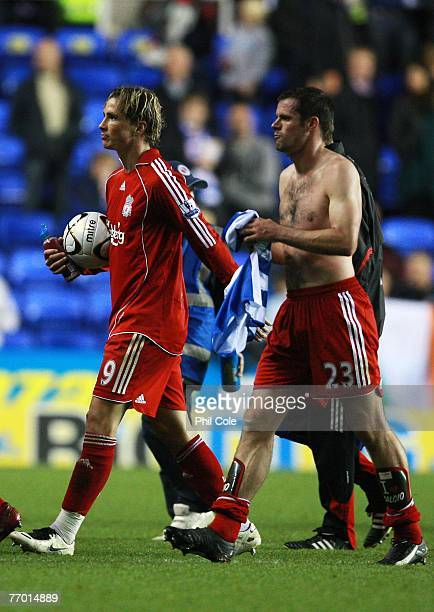 Fernando Torres of Liverpool walks off with the match ball after his hatrick after the Carling Cup third round match between Reading and Liverpool at...
