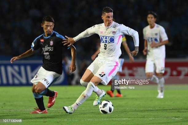 Fernando Torres of Sagan Tosu and Hidemasa Morita of Kawasaki Frontale compete for the ball during the J.League J1 match between Kawasaki Frontale...