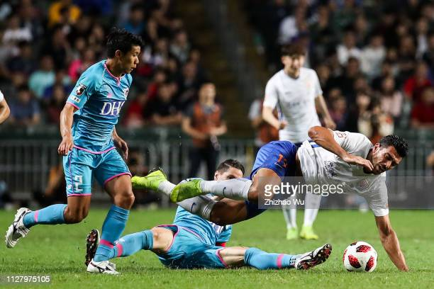 Fernando Torres of Sagan Tosu competes with Pelle Graziano of Shandong Luneng Taishan FC during Tonghai Financial Chinese New Year Cup 2019 between...