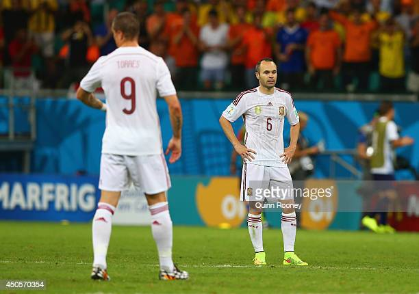 Fernando Torres of Spain and Andres Iniesta look dejected during the 2014 FIFA World Cup Brazil Group B match between Spain and Netherlands at Arena...