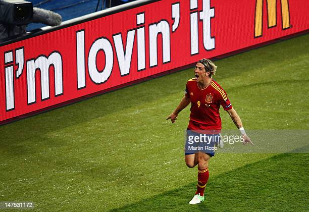 Fernando Torres of Spain celebrates after scoring his team's third goal during the UEFA EURO 2012 final match between Spain and Italy at the Olympic...