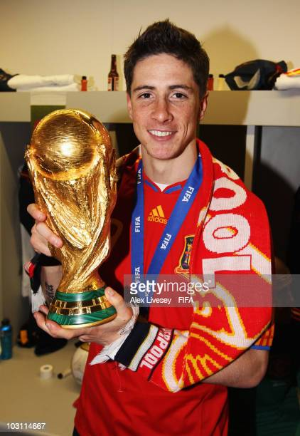 Fernando Torres of Spain celebrates in the Spanish dressing room after they won the 2010 FIFA World Cup at Soccer City Stadium on July 11 2010 in...