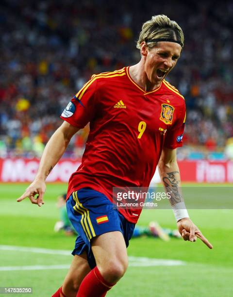 Fernando Torres of Spain celebrates scoring his side's third goal past Gianluigi Buffon of Italy during the UEFA EURO 2012 final match between Spain...