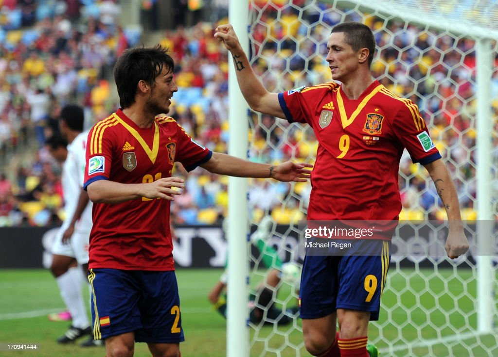 Fernando Torres of Spain celebrates scoring the opening goal with team-mate David Silva (L) during the FIFA Confederations Cup Brazil 2013 Group B match between Spain and Tahiti at the Maracana Stadium on June 20, 2013 in Rio de Janeiro, Brazil.
