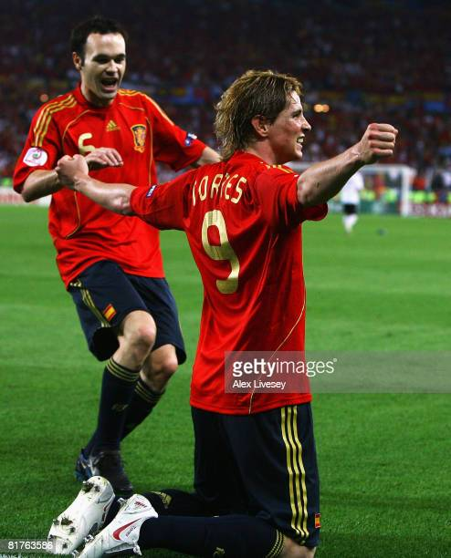 Fernando Torres of Spain celebrates the opening goal with Andres Iniesta of Spain during the UEFA EURO 2008 Final match between Germany and Spain at...