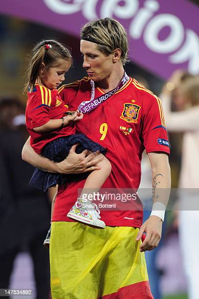 Fernando Torres of Spain celebrates their victory with his daughter Nora Torres after the UEFA EURO 2012 final match between Spain and Italy at the...