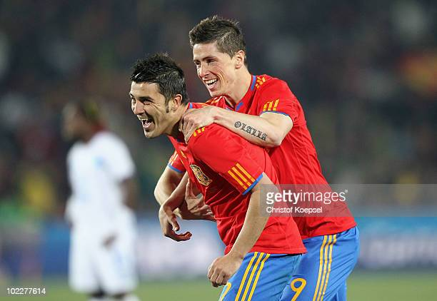 Fernando Torres of Spain celebrates with David Villa of Spain after he scored his teams second goal during the 2010 FIFA World Cup South Africa Group...