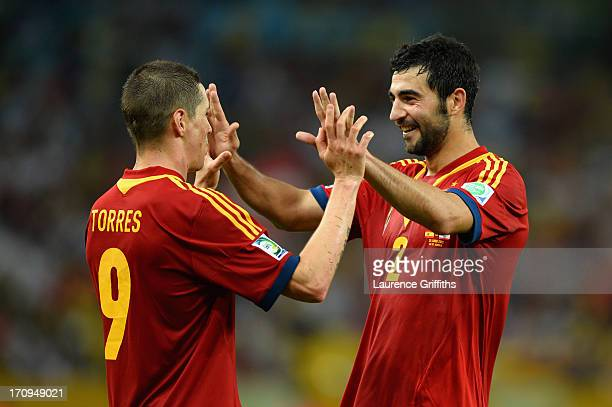 Fernando Torres of Spain celebrates with team-mate Raul Albiol during the FIFA Confederations Cup Brazil 2013 Group B match between Spain and Tahiti...