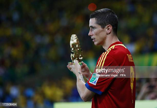Fernando Torres of Spain celebrates with the adidas Gold Boot award after the FIFA Confederations Cup Brazil 2013 Final match between Brazil and...