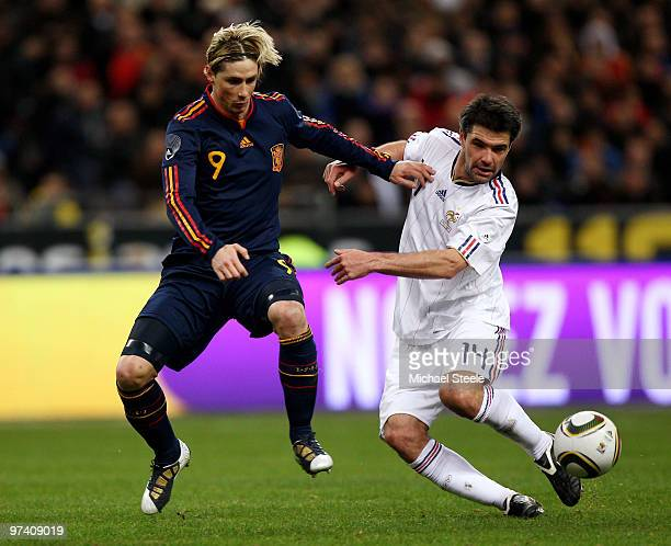 Fernando Torres of Spain challenges Jeremy Toulalan during the during the International friendly match betweem France and Spain at the Stade de...