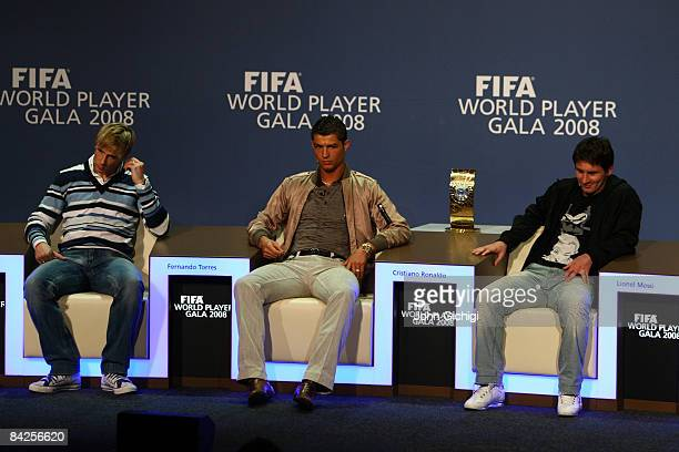 Fernando Torres of Spain Cristiano Ronaldo of Portugal and Lionel Messi of Argentina listen to questions from the media as nominees of FIFA Player of...