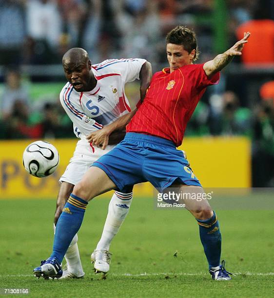 Fernando Torres of Spain fights for the ball with William Gallas of France during the FIFA World Cup Germany 2006 Round of 16 match between Spain and...