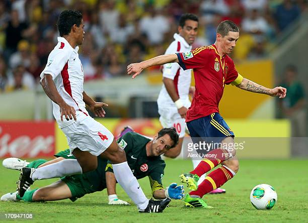 Fernando Torres of Spain goes past Mickael Roche of Tahiti to score his team's ninth goal during the FIFA Confederations Cup Brazil 2013 Group B...