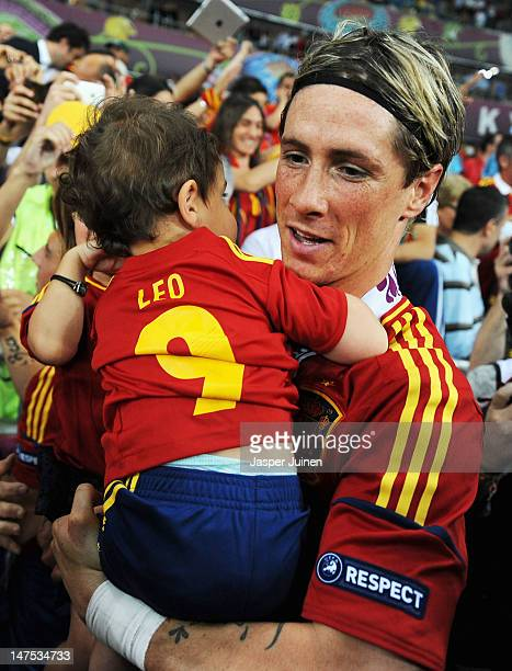 Fernando Torres of Spain holds his daughter Nora Torres and son Leo Torres following victory in the UEFA EURO 2012 final match between Spain and...