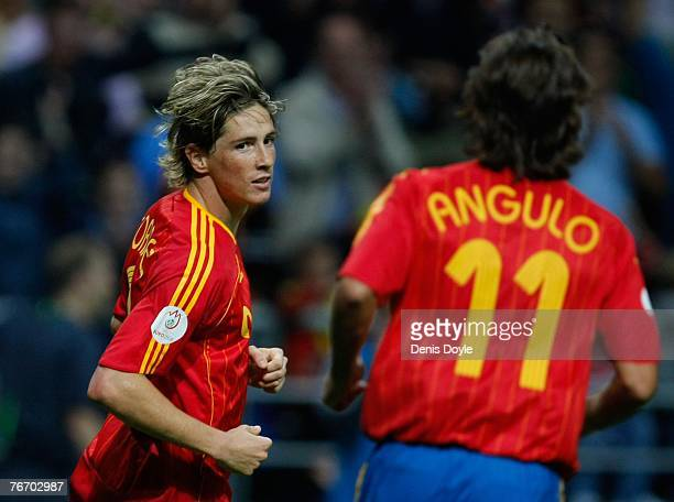 Fernando Torres of Spain is congratulated by Angulo after scoring Spain's second goal during the UEFA Euro 2008 group F qualifier between Spain and...