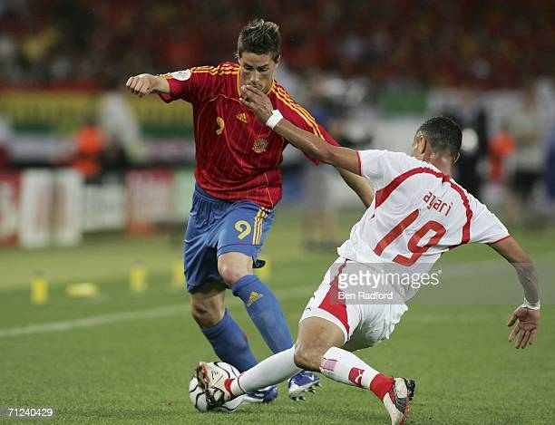 Fernando Torres of Spain is tackled by Anis Ayari of Tunisia during the FIFA World Cup Germany 2006 Group H match between Spain and Tunisia at the...