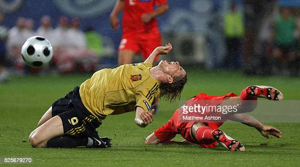 Fernando Torres of Spain is tripped by Sergei Ignashevich of Russia during the UEFA EURO 2008 semifinal soccer match between Russia and Spain at the...