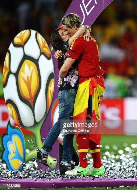 Fernando Torres of Spain kisses his wife Olalla Dominguez on the pitch following victory in the UEFA EURO 2012 final match between Spain and Italy at...