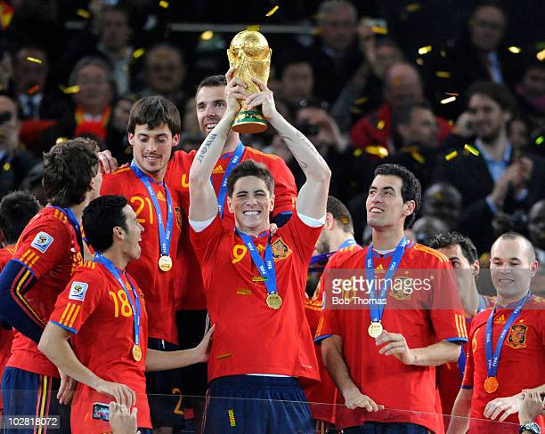 Fernando Torres of Spain lifts the World Cup and celebrates with teammates after the 2010 FIFA World Cup Final between the Netherlands and Spain on...