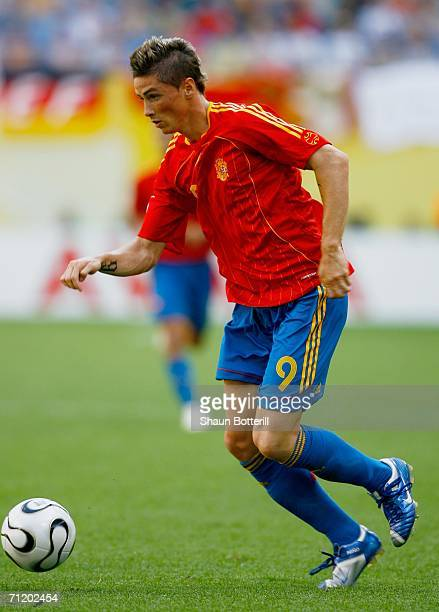Fernando Torres of Spain moves upfield with the ball during the FIFA World Cup Germany 2006 Group H match between Spain and Ukraine played at the...