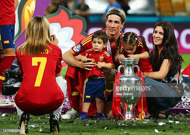 Fernando Torres of Spain poses for a photograph with his wife Olalla Dominguez and their children Leo Torres and Nora Torres on the pitch following...