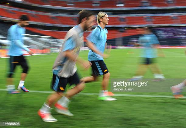 Fernando Torres of Spain runs with his teammates during a training session ahead of the UEFA EURO 2012 quarterfinal match against France at Donbass...