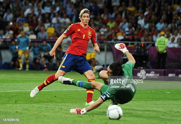 Fernando Torres of Spain scores his side's third goal past Gianluigi Buffon of Italy during the UEFA EURO 2012 final match between Spain and Italy at...